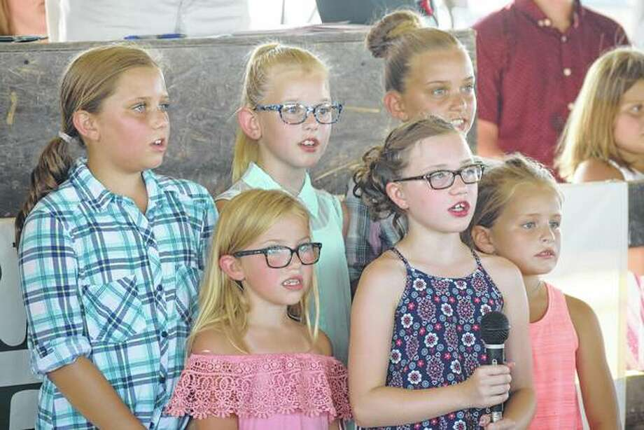 "A group of young Greene County 4-H members kick off the day's festivities with an impromptu singing of the ""Star Spangled Banner"" at the Greene County Fair on Monday."
