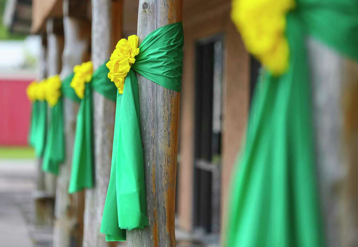 Green and yellow ribbons are tied to columns in front of the Santa Fe Chamber of Commerce along Highway 6, Monday, June 18, 2018 in Santa Fe.
