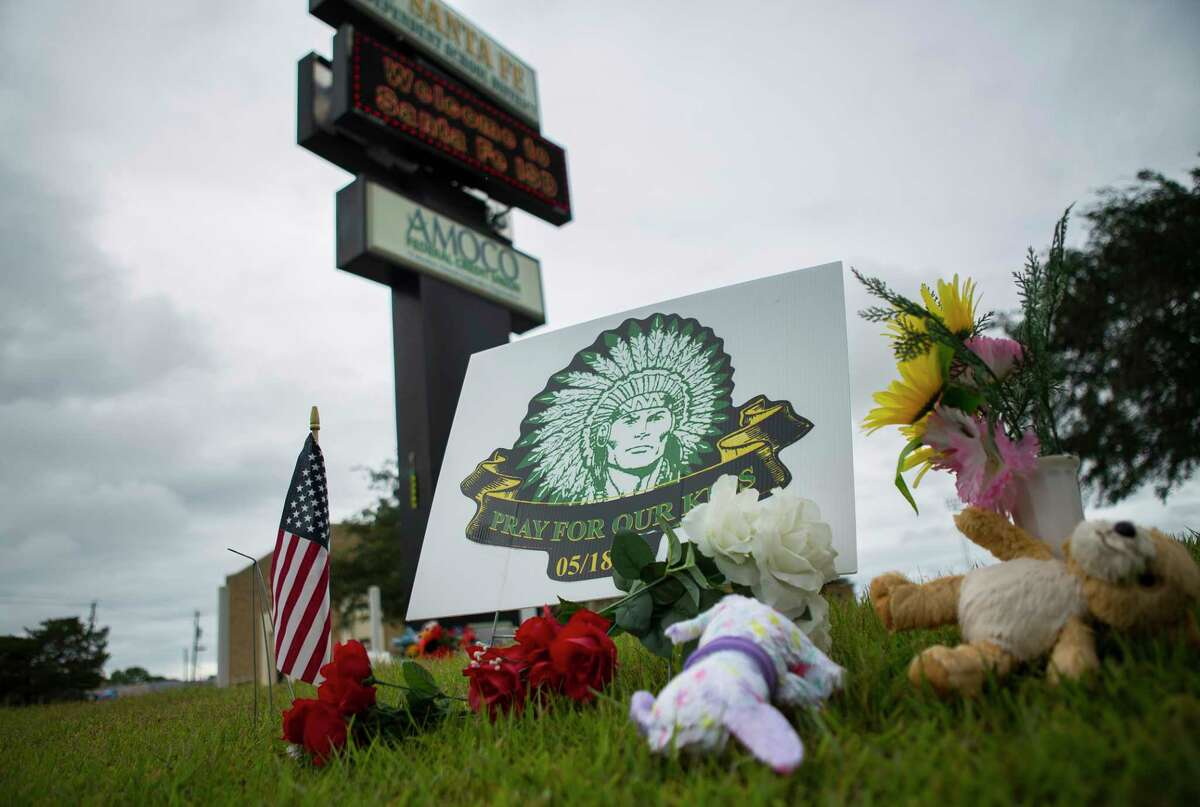 Small memorials sit on the grass along Highway 6 in front of a Santa Fe Independent School District building, Monday, June 18, 2018 in Santa Fe.