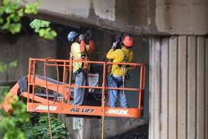 Workers repair a portion of a damaged Interstate 95 bridge in Stamford. The growing number of cars on the highways has taken its toll on infrastructure.