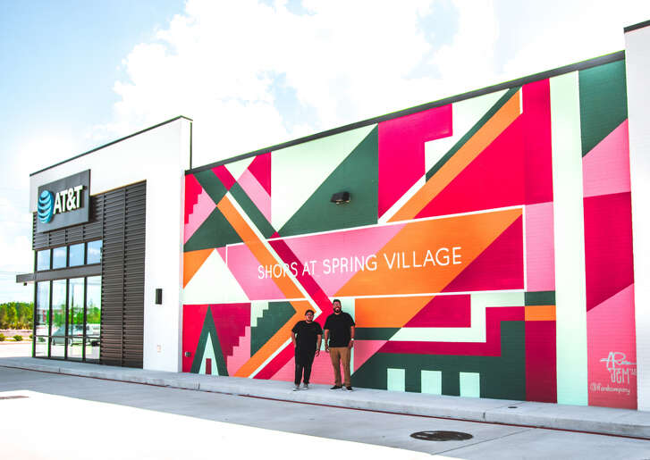 A.J. Rose and David Maldonado completed a mural at the Shops at Spring Village on June 13.