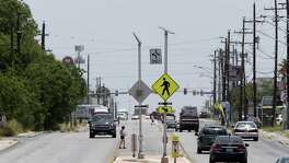 Pedestrians cross Culebra Road west of the intersection with NW 24th Street, Sunday, June 10, 2018. Despite safety measures and hard-to-explain statistical spikes, pedestrian-auto deaths in San Antonio are still troubling. Dozens of people, 50 or 60 some years, die due to being drunk or on drugs, wearing dark clothing at night or because they couldn't navigate one of SA's notorious 7-lane mega roads, such as San Pedro, Blanco, Military, Fredericksburg and, perhaps the worst, Culebra.
