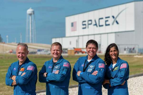 (L-r) Commercial Crew Program astronauts Doug Hurley, Eric Boe, Bob Behnken and Suni Williams outside Launch Complex 39A at NASA's Kennedy Space Center in Florida.