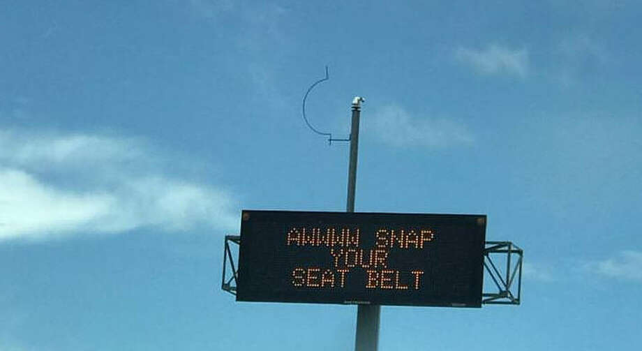 """This week the Texas Department of Transportation's dynamic message signs (DMS) were getting more attention than usual for a hip way of reminding locals to use their seat belts. The message """"Awwww Snap Your Seat Belt"""" hopefully got more people to click it before getting a ticket if their modern cars weren't already screaming at them to do so. Source: Imgur Photo: Imgur"""