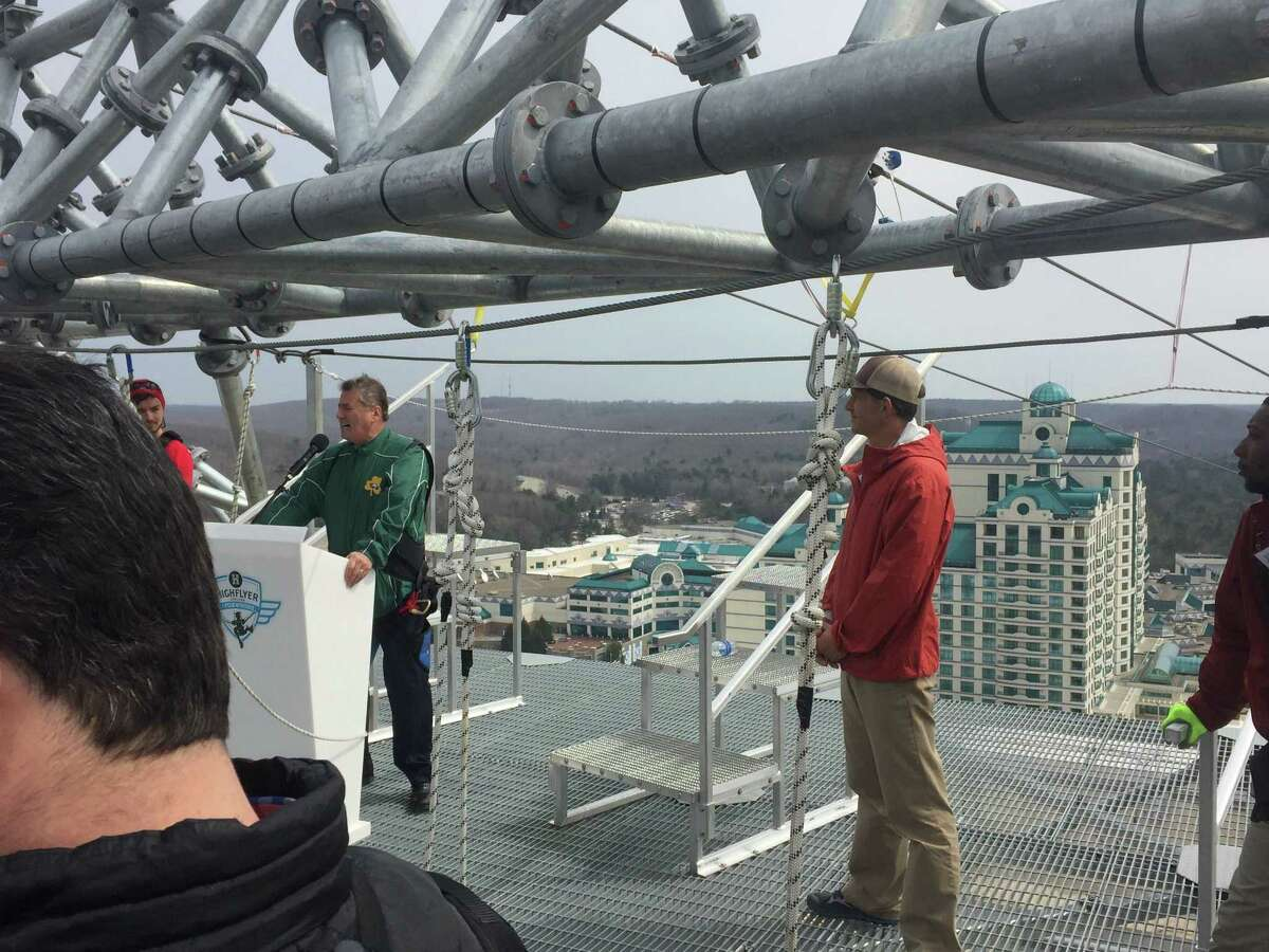 Rappaport, left, gives his remarks at the zipline ribbon-cutting atop the Fox Tower in April.