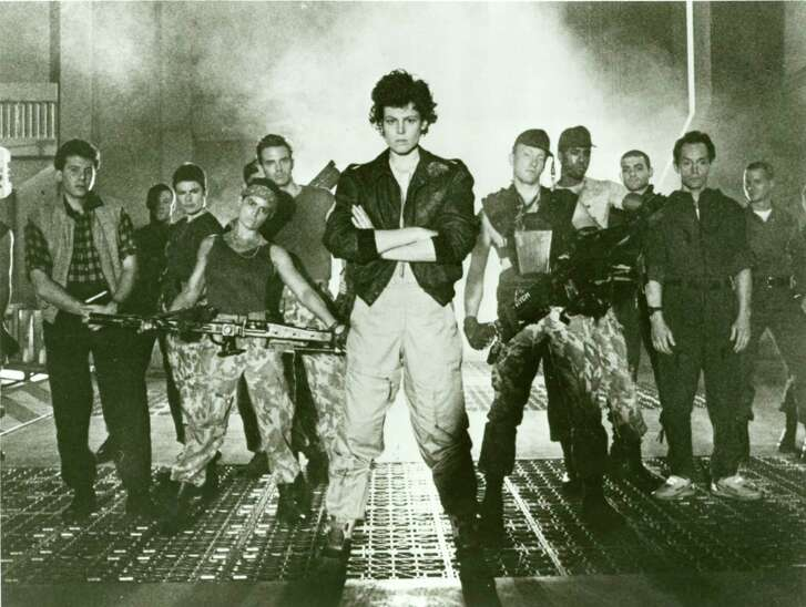 "Sigourney Weaver (center) starred in the 1986 film ""Aliens."""