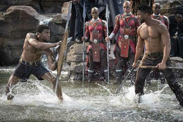 "T'Challa/Black Panther (Chadwick Boseman) and Erik Killmonger (Michael B. Jordan) star in the film ""Black Panther."" (Matt Kennedy/Marvel Studios)"