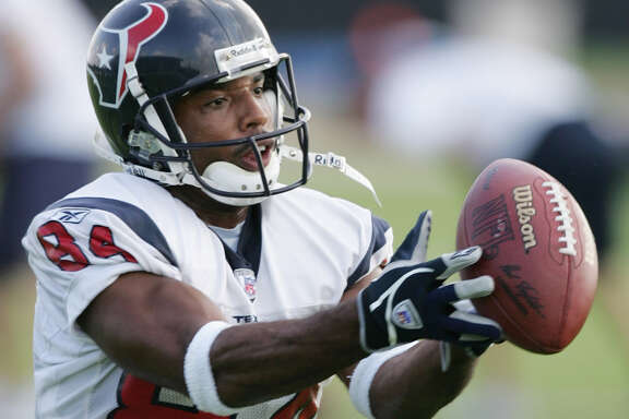 Houston Texans wide receiver J.J. Moses catches a pass during training camp practice Monday, Aug. 2, 2004 in Houston. Moses was the feel-good story of the Houston Texans' 2003 training camp. Listed at 5-foot-6, his steady hands and quick feet helped him seize the punt return job despite being the NFL's shortest player last season. He remains atop the depth chart, although the Texans are essentially holding an open tryout to see if anyone else can do better.