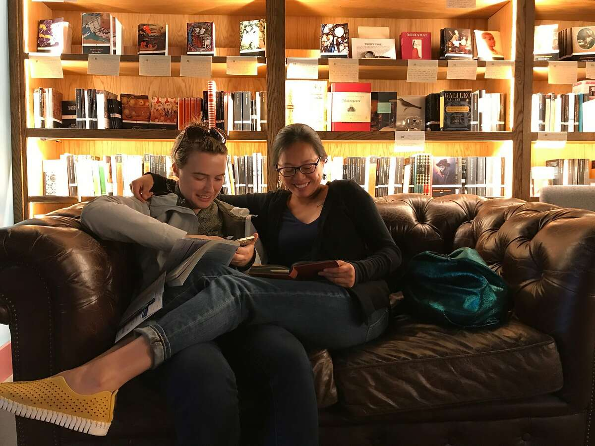 Hannah Howard (left) and Audrey Ho take part in the Silent Reading Party at the Bindery in San Francisco.