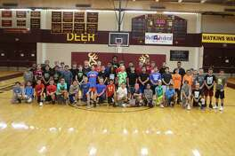 Campers from the Deer Park Basketball Camp get together for a group picture at center court of Cotton Watkins Gym.