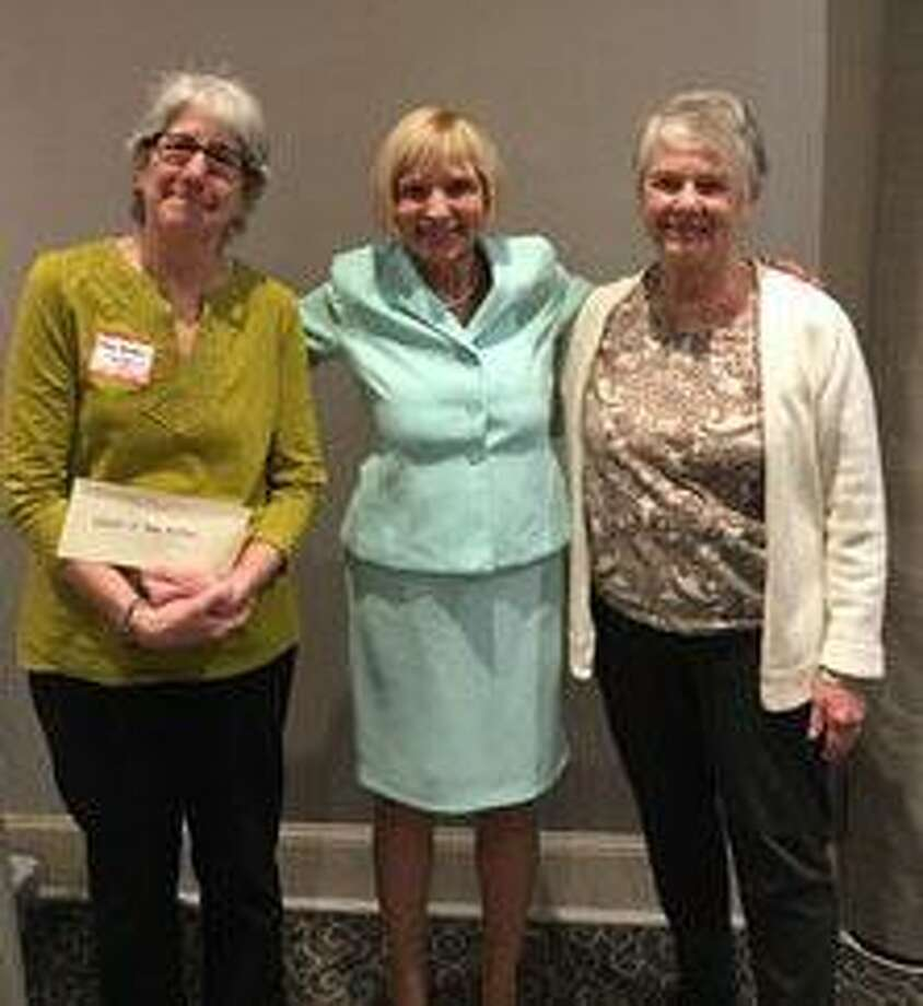 The Women's Club of Danbury/ New Fairfield recently held its annual Celebration of Giving at the Amber Room Colonnade prior to the club's April 2018 general meeting. At the event, a total of $15,500, which the members of the WCDNF raised through its annual poinsettia sale, was distributed to 32 area non-profit organizations. A representative from each agency explained how the money would be used with its programs. Above, from left to right, are Thea Gruber of Wheels of New Milford, Kathy Matusiak, club president, and sponsor Eileen Maloney. Photo: Courtesy Of Women's Club Of Danbury /New Fairfield / The News-Times Contributed