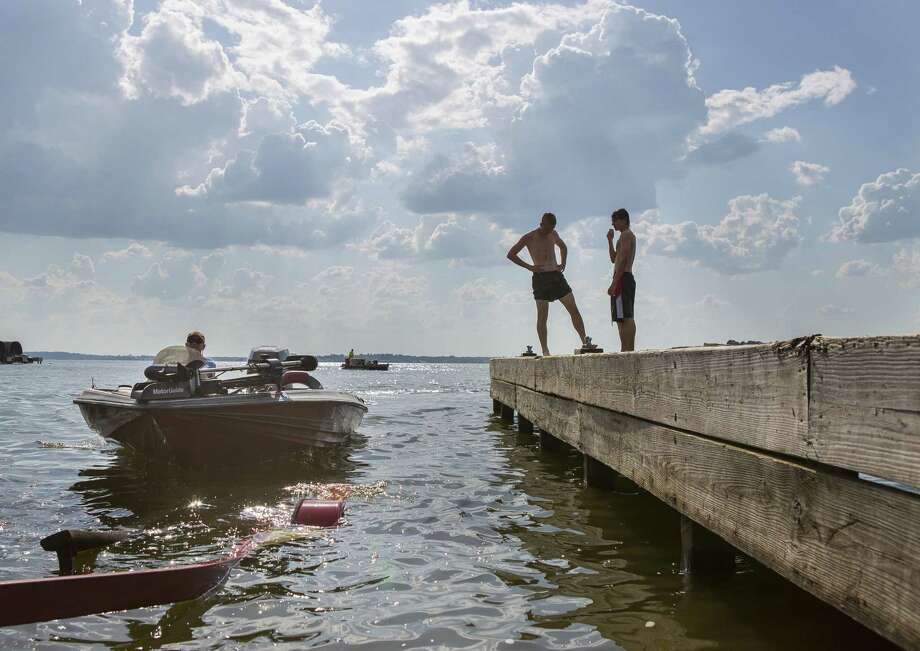 Chris Wallace, of Cold Spring, steers his boat onto its trailer at the public boat launch at the end of County Road 830 on Lake Conroe, Wednesday, June 13, 2018, in Willis. Wallace comes to Lake Conroe to fish twice a week during the summer time. ( Mark Mulligan / Houston Chronicle ) Photo: Mark Mulligan, Houston Chronicle / Houston Chronicle / © 2018 Houston Chronicle