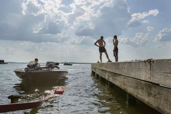 Chris Wallace, of Cold Spring, steers his boat onto its trailer at the public boat launch at the end of County Road 830 on Lake Conroe, Wednesday, June 13, 2018, in Willis. Wallace comes to Lake Conroe to fish twice a week during the summer time. ( Mark Mulligan / Houston Chronicle )