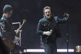 Guitarist The Edge, left, and singer Bono perform in Washington last week.