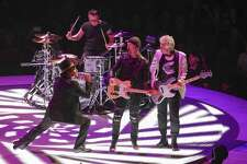 Singer Bono, from left, drummer Larry Mullen, Jr., guitarist The Edge and bassist Adam Clayton of the band U2 perform at Capitol One Arena in Washington, D.C., on June, 17.