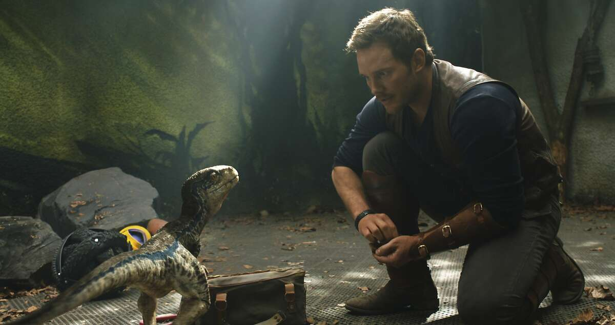 """This image released by Universal Pictures shows Chris Pratt in a scene from the upcoming """"Jurassic World: Fallen Kingdom."""""""