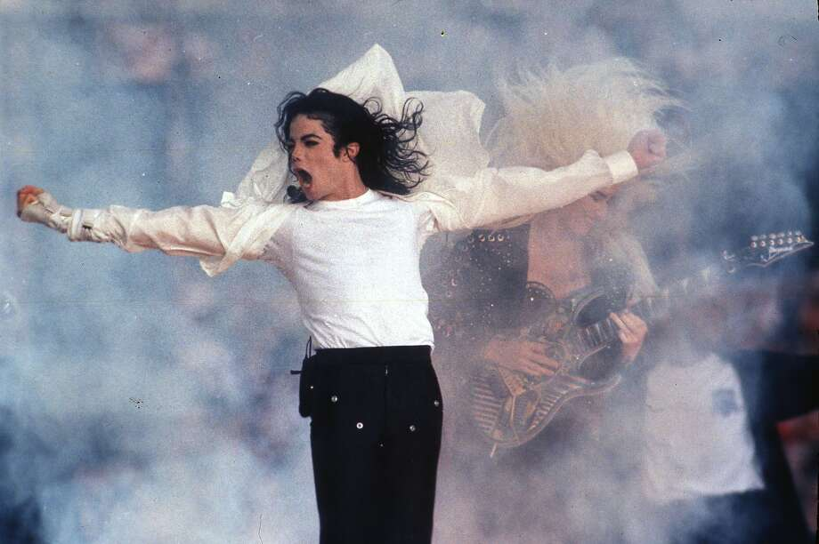 FILE - This Feb. 1, 1993 file photo shows Pop superstar Michael Jackson performing during the halftime show at the Super Bowl. Click through to see famous musicians that once played in Beaumont. Photo: Rusty Kennedy, Associated Press