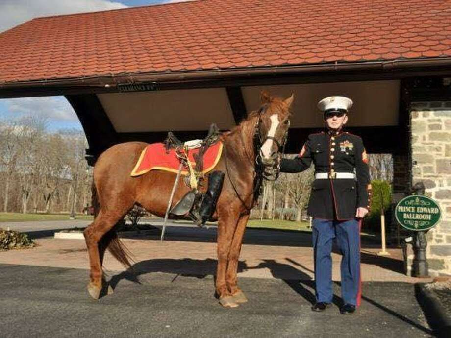 Melody was an aged Morgan mare who had served as the riderless horse (symbolically carrying empty boots reversed in the stirrups) at more than 700 military funerals over the past decade. Melody, shown her owner, Marine Corps veteran Richard Kowalker, will be memorialized June 30 at CDHR farm Autumn Ridge in East Hampton. Photo: Contributed Photo