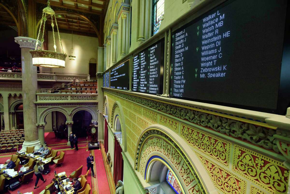 Names of members of the Assembly and how they are voting are seen on a board above the Assembly floor at the Capitol on Tuesday, June 19, 2018, in Albany, N.Y. (Paul Buckowski/Times Union)