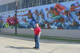"""Harris County District Clerk Chris Daniel shows off changes to """"The Rebirth of Our Nationality"""" mural in before-and-after photos."""