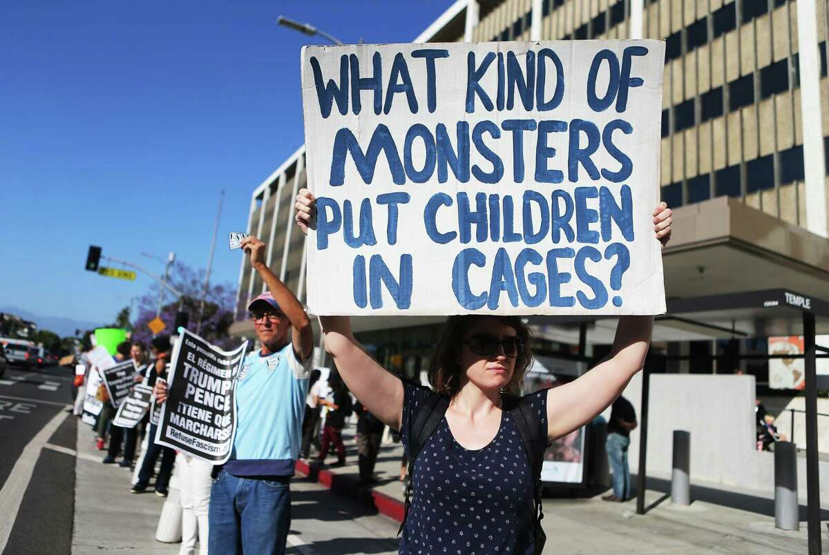 Protestors demonstrate against the separation of migrant children from their families in front of the Federal Building in Los Angeles on Monday.