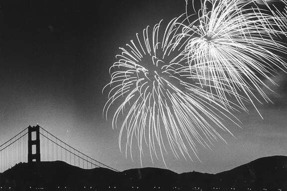 Fireworks over Crissy Field, with the Golden Gate Bridge in the background, July 4, 1980  Photo ran 07/05/1980, P. 10