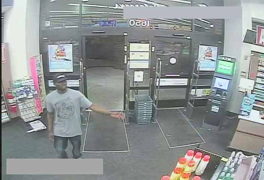 Surveillance photos of the robbery suspects.