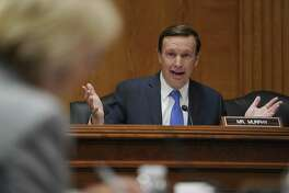 Senate Subcommittee on Labor, Health and Human Services, Education, and Related Agencies Appropriations member Sen. Chris Murphy, D-Conn., questions Education Secretary Betsy DeVos, left, during a Senate Subcommittee on Labor, Health and Human Services, Education, and Related Agencies Appropriations hearing to review the Fiscal Year 2019 funding request and budget justification for the U.S. Department of Education on Capitol Hill in Washington, Tuesday, June 5, 2018. (AP Photo/Carolyn Kaster)