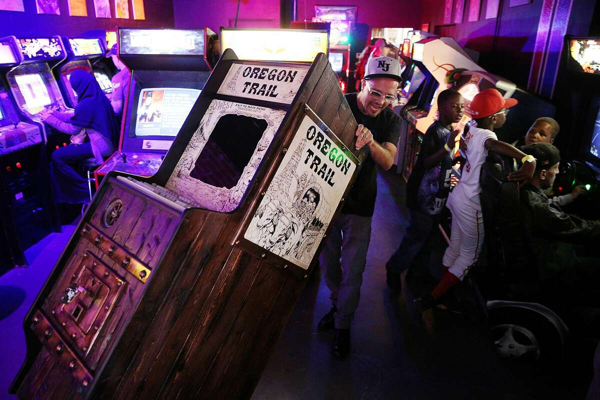 High Scores Arcade co-owner Shawn Livernoche with the arcade's new Oregon Trail game, Saturday, June 16, 2018, in Hayward, Calif.