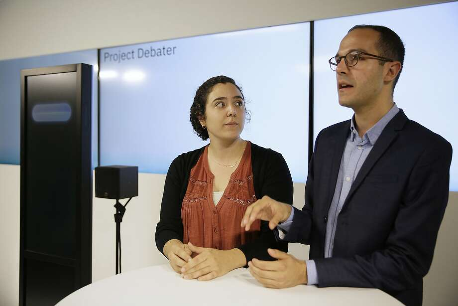 Noa Ovadia, left, and Dan Zafrir, right, prepare for their debate against the IBM Project Debater, Monday, June 18, 2018, in San Francisco. IBM on Monday will pit a computer against two human debaters in the first public demonstration of artificial intelligence technology it's been working on for more than five years. The system, called Project Debater, is designed to be able to listen to an argument, then respond in a natural-sounding way, after pulling in evidence it collects from Wikipedia, journals, newspapers and other sources to make its point. (AP Photo/Eric Risberg) Photo: Eric Risberg, Associated Press