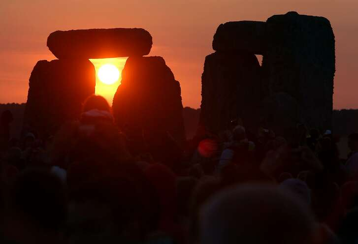The rising sun is seen through the standing stones at the prehistoric monument Stonehenge, near Amesbury in Southern England, on June 21, 2014, as revelers gather to celebrate the 2014 summer solstice, marking the longest day of the year. The festival, which dates back thousands of years, celebrates the longest day of the year when the sun is at its maximum elevation. Modern druids and people gather at the landmark Stonehenge every year to see the sun rise on the first morning of summer.  AFP PHOTO / GEOFF CADDICKGEOFF CADDICK/AFP/Getty Images