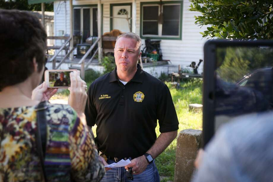 Precinct 3 Constable Ryan Gable speaks with media after the constable's office installed a new window air conditioning unit last year for a needed resident in Willis. Gable is again launching his air conditioning project for needy residents. Photo: Michael Minasi, Staff Photographer / Houston Chronicle / © 2017 Houston Chronicle