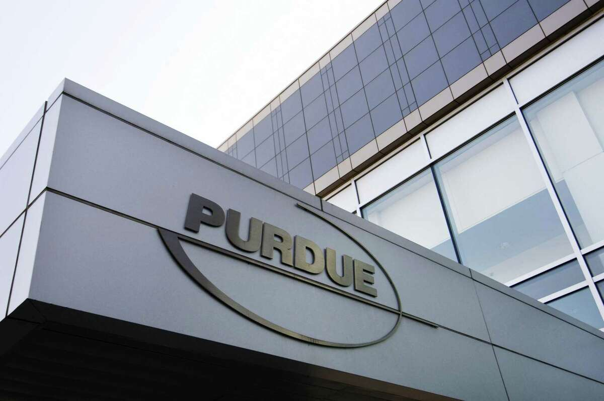 Purdue Pharma, the Stamford-based maker of the prescription opioid painkiller OxyContin, laid off about 350 employees this week, about half of them with the company's already-downsized sales force.
