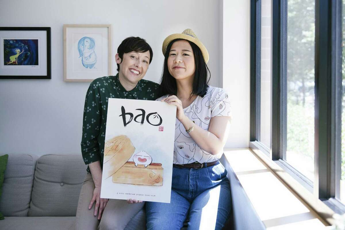 """Domee Shi (right) who created and directed Pixar's new short, """"Bao,"""" poses with producer Becky Neiman-Cobb at the studio's Emeryville headquarters."""
