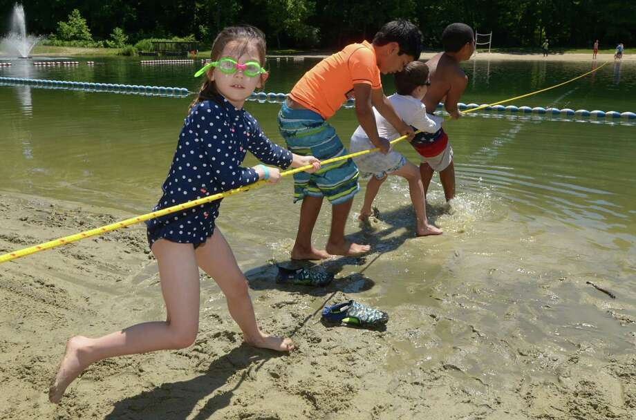 Five-year-old Adelaide Schoetz, Ayyan Kitchlew,  7, Alexander Shoetz, 7, Juelz Marshall, 9, participate in a game of Tug-O-War across the pond as Wilton residents enjoy Wilton Day at Merwin Meadows Saturday, June 16th 2018, in Wilton, Conn. The Wilton Parks and Recreation Department sponsored Wilton Day in the hopes the event would introduce Merwin Park to new Wilton residents and to reintroduce Merwin to the Wilton residents who may not have seen the improvements and changes to the park. Photo: Erik Trautmann / Hearst Connecticut Media / Norwalk Hour