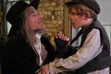 """Donald Corren, as Fagin, and Elijah Rayman, as Oliver, in Goodspeed Musicals' """"Oliver!"""" The show will be on stage at The Goodspeed in East Haddam, June 29 through Sept. 8."""