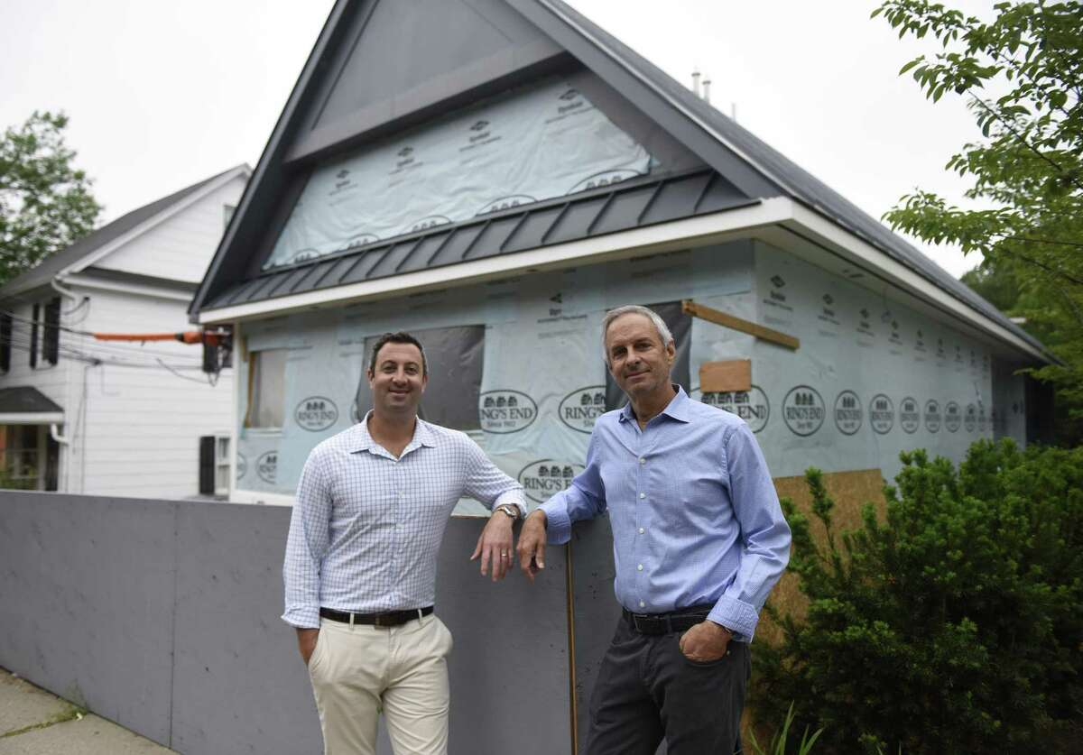 Sanders Equities Executive Vice President Jordan Sanders, left, and his father President Arthur Sanders, pose outside the new Sanders Equities executive office on Arch Street in Greenwich, Conn. Wednesday, June 13, 2018. The real estate investment and management firm is branching out from Long Island to Connecticut by building its executive headquarters in Greenwich.