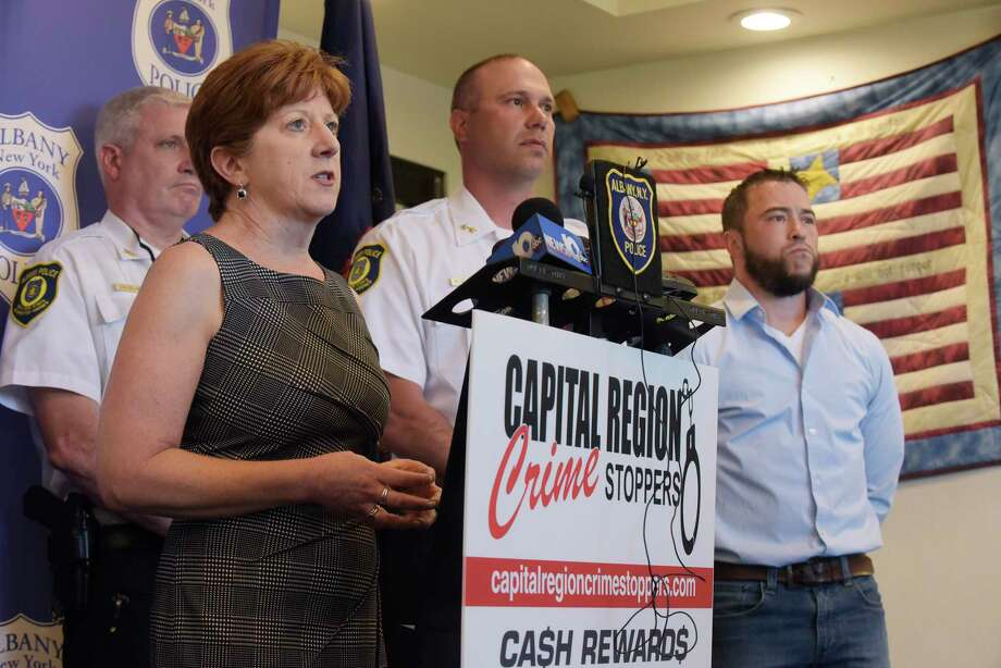 Albany Mayor Kathy Sheehan, left, along with Acting Albany Police Chief Robert Sears, center, and Mickey Myers, right, president of Capital Region Crime Stoppers, take part in a press conference at the Albany Police Headquarters on Tuesday, June 19, 2018, in Albany, N.Y.  (Paul Buckowski/Times Union) Photo: Paul Buckowski, Albany Times Union / (Paul Buckowski/Times Union)