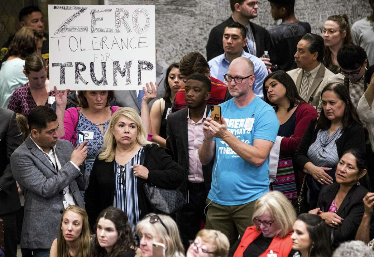 A crowd fills the Legacy Room at City Hall as Mayor Sylvester Turner speaks during a news conference opposing the proposal to place immigrant children separated from their parents at the border in a facility just east of downtown on Tuesday, June 19, 2018, in Houston. ( Brett Coomer / Houston Chronicle )
