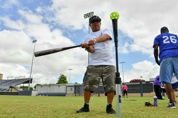 Augustin Rojas bats at the 3rd annual Eva's Heroes Baseball Clinic Saturday morning at St. Mary's U niversity's Dickson Stadium.