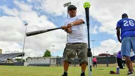 Augustin Rojas bats at the 3rd annual Eva's Heroes Baseball Clinic Saturday morning at St. Mary's U niversity's Dickson Stadium.