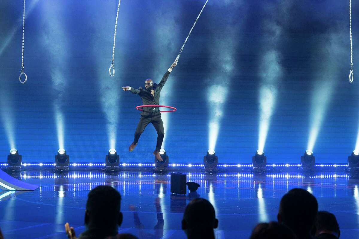 Obaroene Otitigbe, an art teacher in Albany public schools, performs his aerial hooping act on the premiere of the second season of