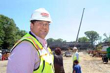 Randy Feda of the Gilbane Building Company during the topping ceremony at the site of the new New Lebanon School in the Byram section of Greenwich, Conn., Tuesday, June 12, 2018. Feda said he attended New Lebanon School in the 1970s. The final piece of structural steel was adorned by an American Flag as it was put in place by workers from the Gilbane Building Company.