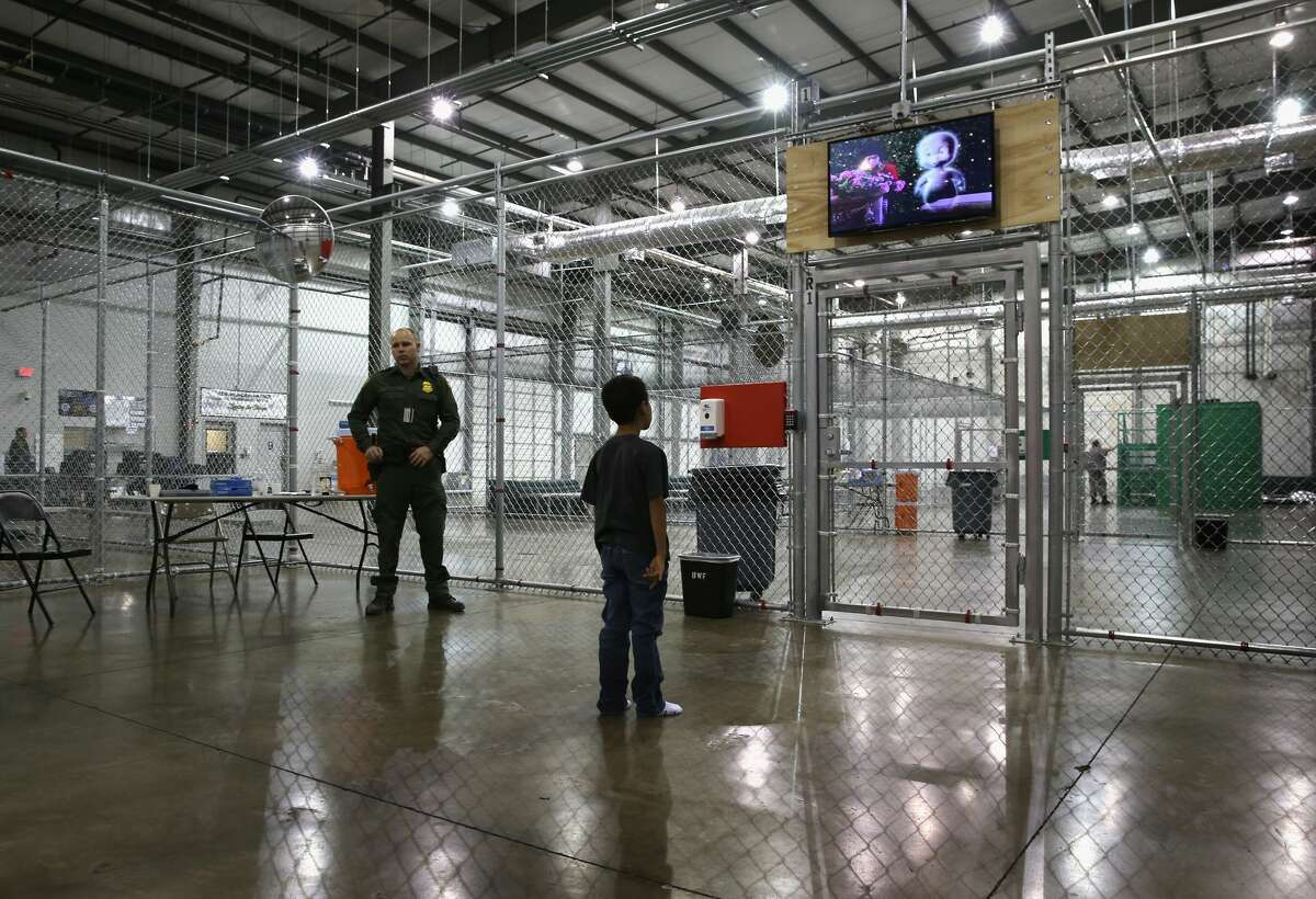 MCALLEN, TX - SEPTEMBER 08: A boy from Honduras watches a movie at a detention facility run by the U.S. Border Patrol on September 8, 2014 in McAllen, Texas. The Border Patrol opened the holding center to temporarily house the children after tens of thousands of families and unaccompanied minors from Central America crossed the border illegally into the United States during the spring and summer. Although the flow of underage immigrants has since slowed greatly, thousands of them are now housed in centers around the United States as immigration courts process their cases. (Photo by John Moore/Getty Images)