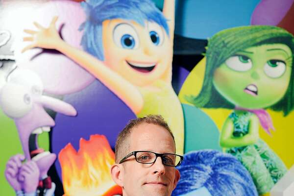 """Academy Award-winning director Pete Docter, who's new animated film """"Inside Out"""" is due for release in June, poses for a portrait with a promotional display depicting the films characters, at the Pixar Studios in Emeryville, CA on Friday, April 24, 2015."""