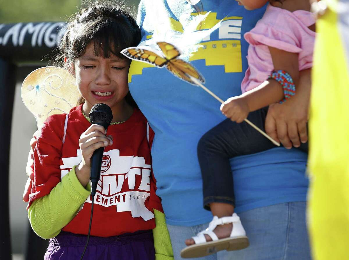 Akemi Vargas, 8, cries as she talks about being separated from her father during an immigration family separation protest in front of the Sandra Day O'Connor U.S. District Court building, Monday, June 18, 2018, in Phoenix. An unapologetic President Donald Trump defended his administration's border-protection policies Monday in the face of rising national outrage over the forced separation of migrant children from their parents. (AP Photo/Ross D. Franklin)