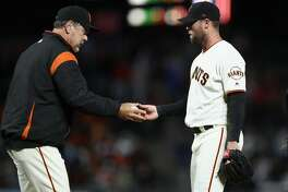 SAN FRANCISCO, CA - JUNE 18:  Manager Bruce Bochy takes out Hunter Strickland #60 of the San Francisco Giants after he gave up a hit to Miguel Rojas #19 of the Miami Marlins that scored the go-ahead run in the bottom of the ninth inning against the San Francisco Giants at AT&T Park on June 18, 2018 in San Francisco, California.  (Photo by Ezra Shaw/Getty Images)