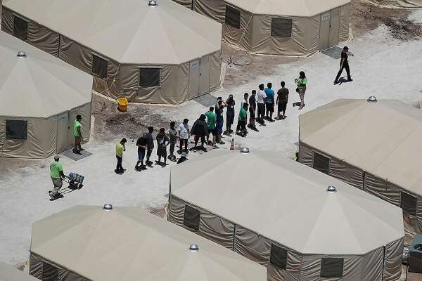 TORNILLO, TX - JUNE 19:  Children and workers are seen at a tent encampment recently built near the Tornillo Port of Entry on June 19, 2018 in Tornillo, Texas. The Trump administration is using the Tornillo tent facility to house immigrant children separated from their parents after they were caught entering the U.S. under the administration's zero tolerance policy.  (Photo by Joe Raedle/Getty Images)