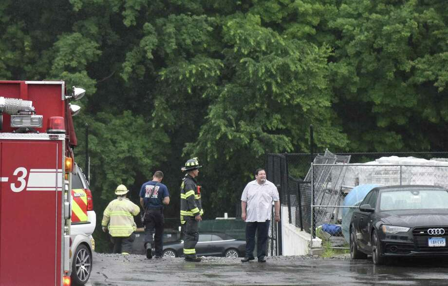 Firefighters respond to an oil leak at the Audi dealership on West Putnam Avenue in Greenwich, Conn. Wednesday, June 13, 2018. Crews were dispatched to prevent any spillage into local waterways. Photo: Tyler Sizemore / Hearst Connecticut Media / Greenwich Time