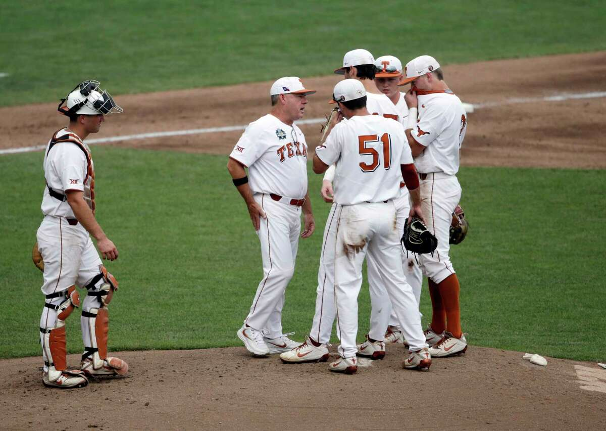 Texas coach David Pierce talks to his players on the mound in the second inning of an NCAA College World Series baseball elimination game against Florida in Omaha, Neb., Tuesday, June 19, 2018. (AP Photo/Nati Harnik)